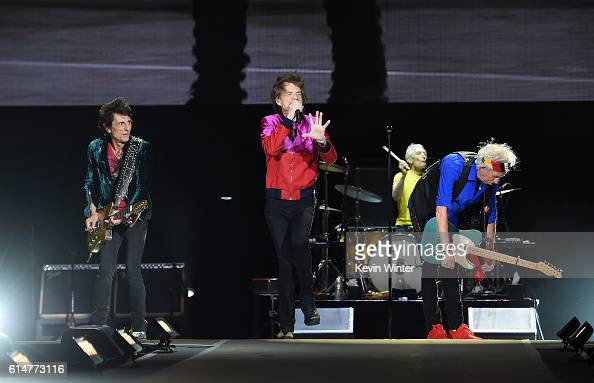 Musician Ronnie Wood singer Mick Jagger musicians Charlie Watts and Keith Richards of The Rolling Stones perform during Desert Trip at the Empire...