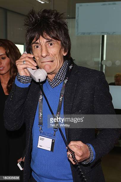 Musician Ronnie Wood speaks on the phone on the trading floor during the BGC Charity Day 2013 at BGC Partners on September 11 2013 in London England