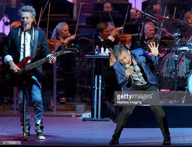 Musician Ross Valory and singer Arnel Pineda of Journey perform onstage during Hollywood Bowl Opening Night 2015 at the Hollywood Bowl on June 20...
