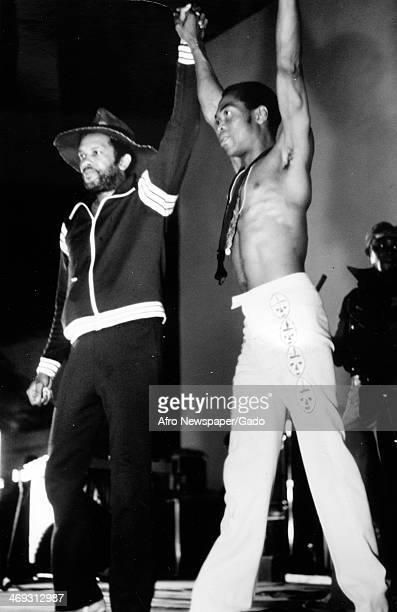 Musician Roy Ayers on stage with arms raised 1970