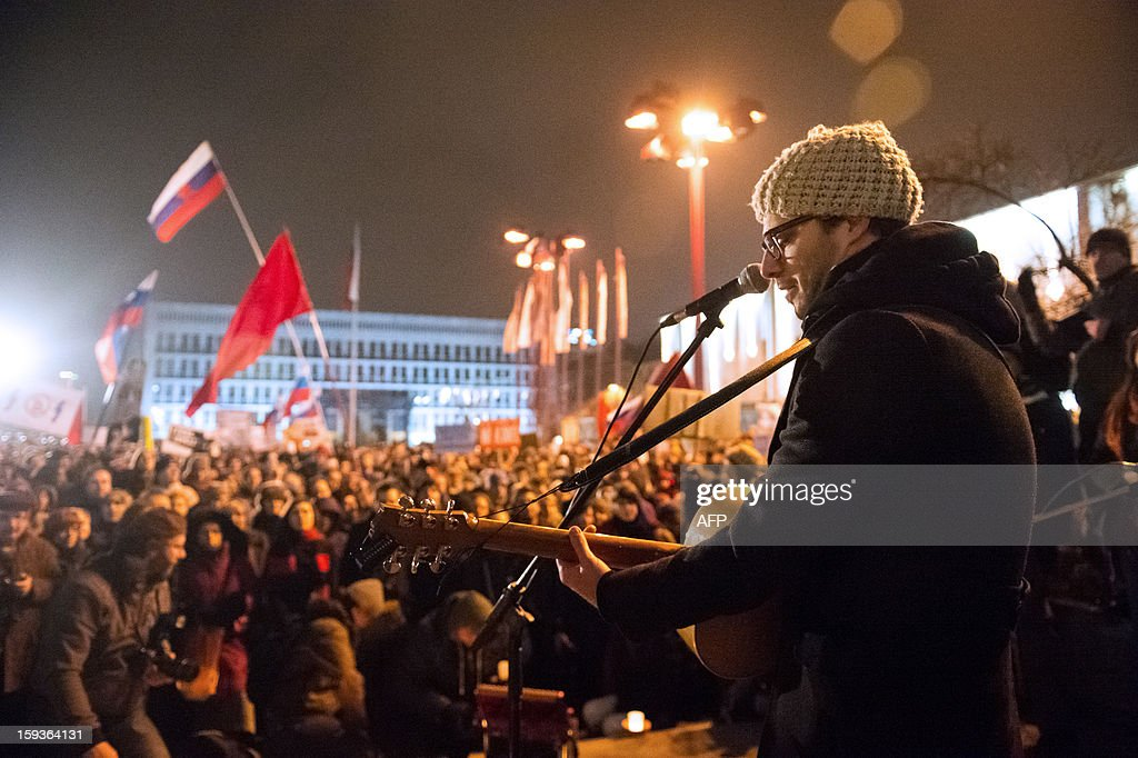 Musician Rudi Bucar performs during a demonstration against political corruption and the Slovenian Prime Minister, in Ljubljana, on January 11, 2013. Several thousand people in Slovenia's capital today joined in one of the biggest anti-government rallies in recent months, demanding the resignation of Prime Minister Janez Jansa, who has been accused of corruption. State radio estimated over 10,000 people took part in the protest called by civil groups under the slogan 'For the government's resignation and the renewal of Slovenia.' Police put the figure closer to 8,000. AFP PHOTO / Jure Makovec