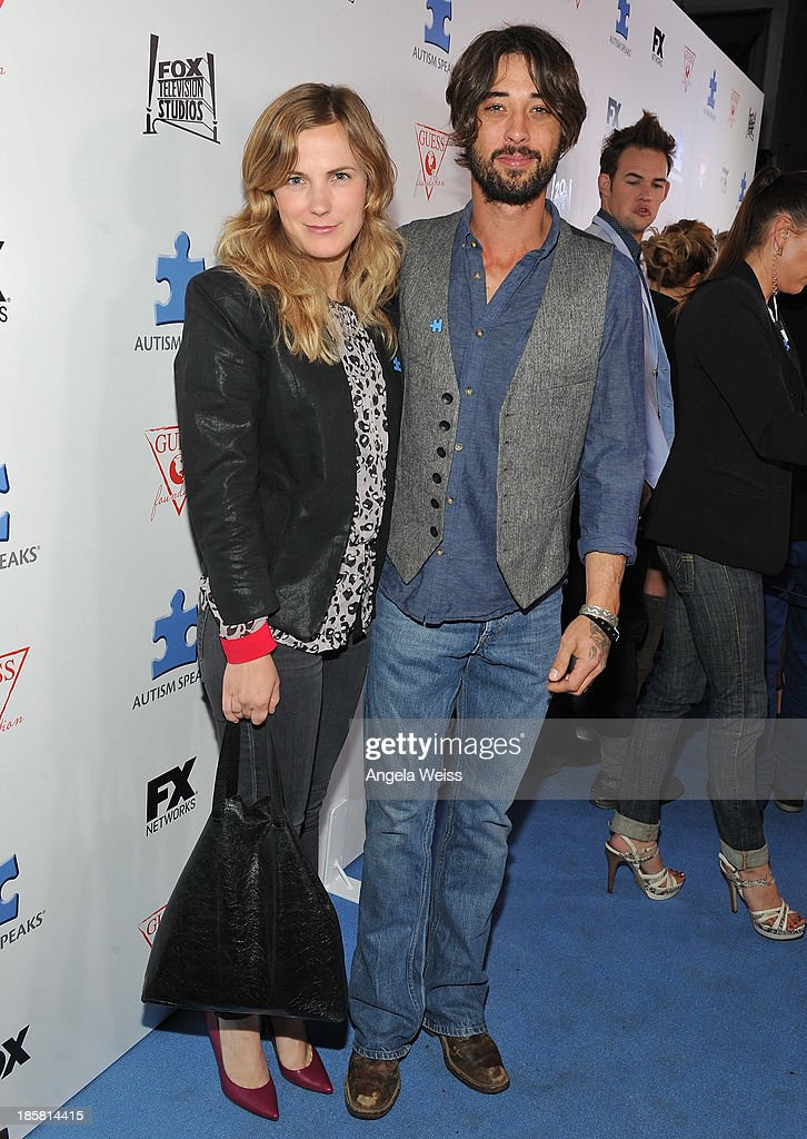 Musician <a gi-track='captionPersonalityLinkClicked' href=/galleries/search?phrase=Ryan+Bingham&family=editorial&specificpeople=4556291 ng-click='$event.stopPropagation()'>Ryan Bingham</a> (R) and guest attend Autism Speaks' 3rd Annual 'Blue Jean Ball' presented by The GUESS Foundation at Boulevard 3 on October 24, 2013 in Hollywood, California.
