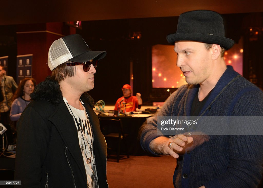 Musician Ryan Cabrera (L) and singer Gavin DeGraw pose backstage at the GRAMMYs Dial Global Radio Remotes during The 55th Annual GRAMMY Awards at the STAPLES Center on February 7, 2013 in Los Angeles, California.