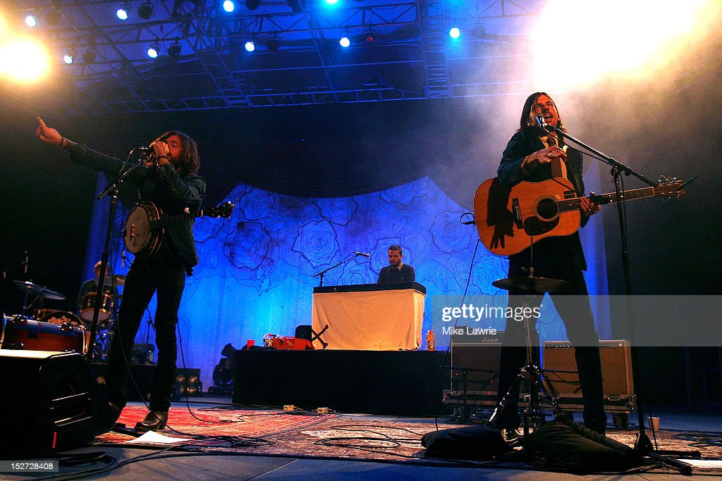 Musician Scott Avett (L) and Seth Avett of the Avett Brothers performs at SummerStage at Rumsey Playfield, Central Park on September 24, 2012 in New York City.