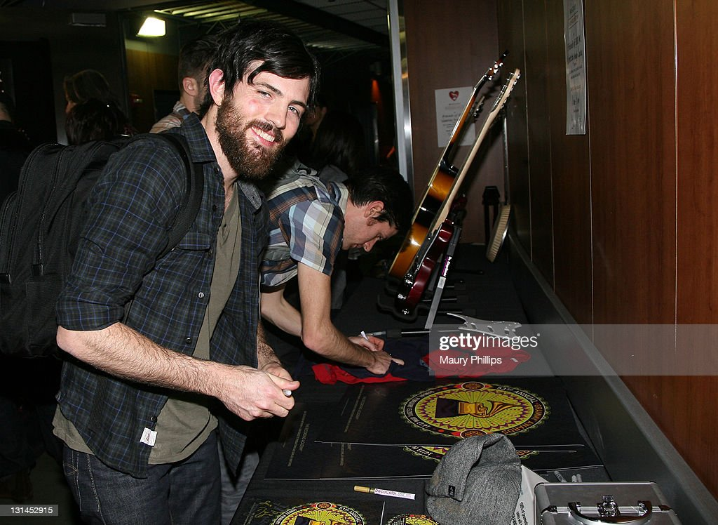 Musician Scott Avett of <a gi-track='captionPersonalityLinkClicked' href=/galleries/search?phrase=The+Avett+Brothers&family=editorial&specificpeople=4270503 ng-click='$event.stopPropagation()'>The Avett Brothers</a> poses at the MusiCares signing booth during The 53rd Annual GRAMMY Awards at Staples Center on February 12, 2011 in Los Angeles, California.