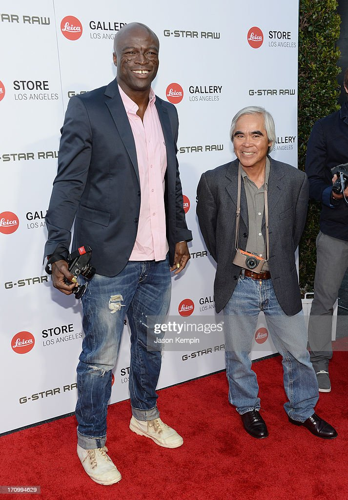 Musician Seal and photographer Nick Ut attend the Leica Store Los Angeles grand opening on June 20, 2013 in Los Angeles, California.