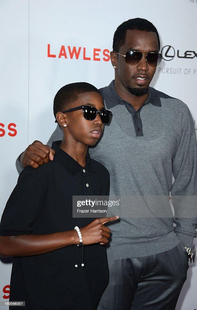 Musician Sean John Combs (P. Diddy) with son Quincy Combs arrive at the Premiere of the Weinstein Company's 'Lawless' at ArcLight Cinemas on August 22, 2012 in Hollywood, California.