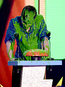 Musician Shawn Mendes gets slimed onstage during Nickelodeon's 28th Annual Kids' Choice Awards held at The Forum on March 28 2015 in Inglewood...