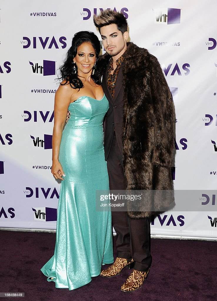 Musician Sheila E. and Adam Lambert arrive at the 'VH1 Divas' 2012 at The Shrine Auditorium on December 16, 2012 in Los Angeles, California.