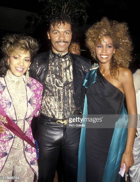 Musician Sheila E musician Ray Parker Jr and singer Whitney Houston attend the 13th Annual American Music Awards on January 27 1986 at Shrine...