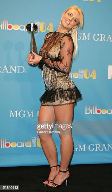 Musician Singer Britney Spears poses with her Hot Dance Sales Single of the Year award for 'Me Against The Music' at the 2004 Billboard Music Awards...