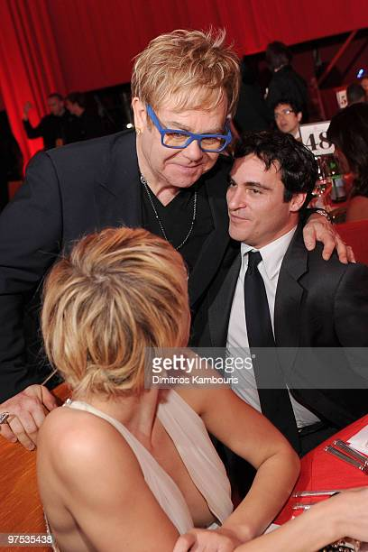 WEST HOLLYWOOD CA MARCH 07 *EXCLUSIVE ACCESS PREMIUM RATES APPLY* Musician Sir Elton John and actor Joaquin Phoenix attend the 18th Annual Elton John...