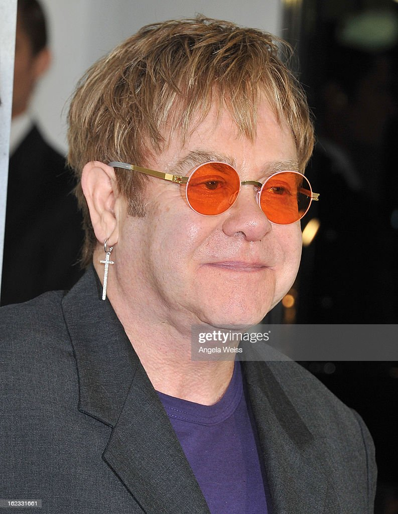 Musician Sir <a gi-track='captionPersonalityLinkClicked' href=/galleries/search?phrase=Elton+John&family=editorial&specificpeople=171369 ng-click='$event.stopPropagation()'>Elton John</a> attends Tom Ford's cocktail event in support of Project Angel Food at TOM FORD on February 21, 2013 in Beverly Hills, California.
