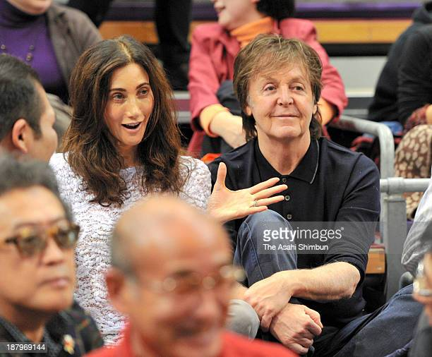 Musician Sir Paul McCartney and his wife Nancy Shevell watch sumo matches during day five of the Grand Sumo Kyushu Tournament at Fukuoka Convention...