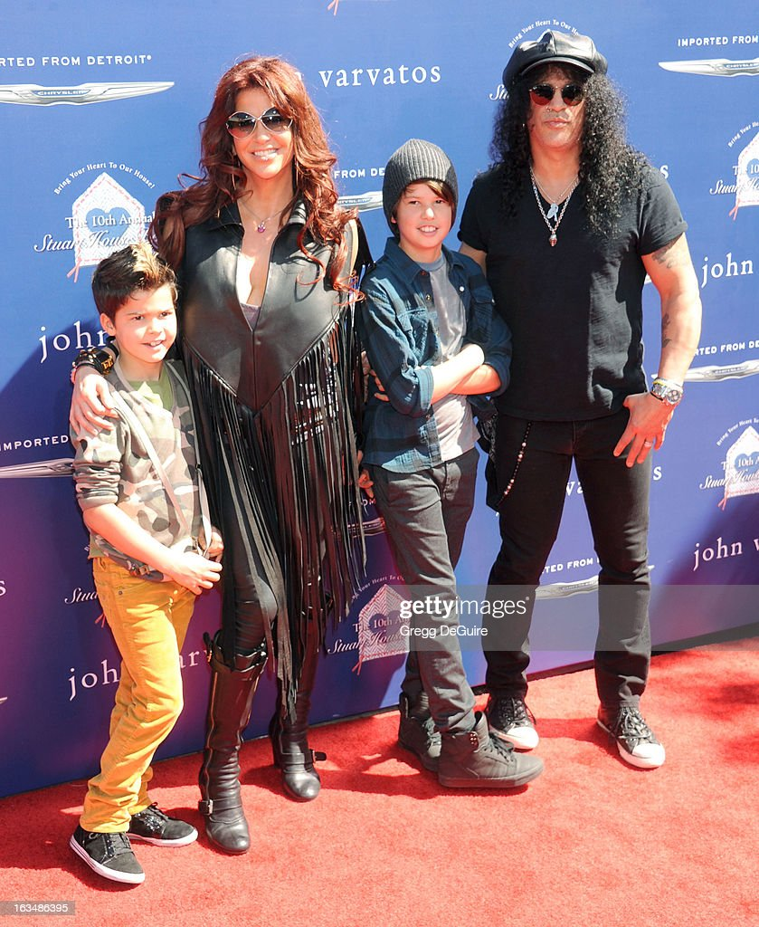 Musician Slash (R), <a gi-track='captionPersonalityLinkClicked' href=/galleries/search?phrase=Perla+Ferrar&family=editorial&specificpeople=233501 ng-click='$event.stopPropagation()'>Perla Ferrar</a>, sons Cash and London arrive at John Varvatos 10th Annual Stuart House Benefit at John Varvatos Los Angeles on March 10, 2013 in Los Angeles, California.