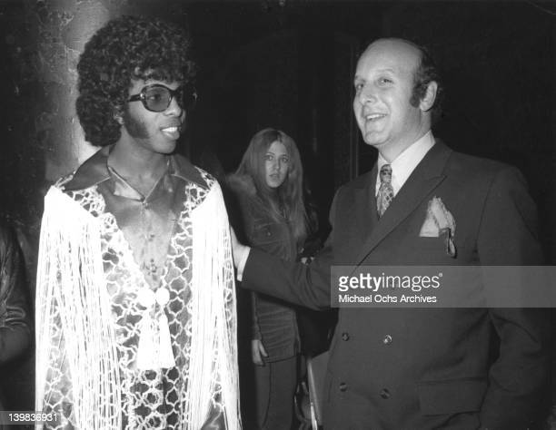 Musician Sly Stone of the psychedelic soul group 'Sly And The Family Stone' poses for a portrait with record executive Clive Davis in 1970