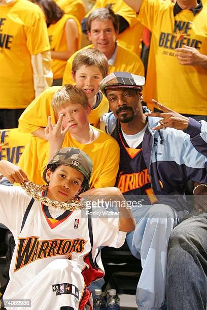 Musician Snoop Dogg poses with some young fans as the watch the Golden State Warriors play the Dallas Mavericks in Game Six of the 2007 NBA Playoffs...
