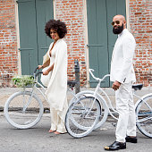 Musician Solange Knowles and her fiance music video director Alan Ferguson ride bicycles on the streets of the French Quarter en route to their...