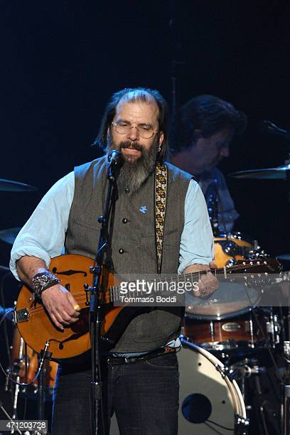 Musician Steve Earle performs on stage during the 3rd Light Up the Blues Concert to benefit Autism Speaks held at the Pantages Theatre on April 25...