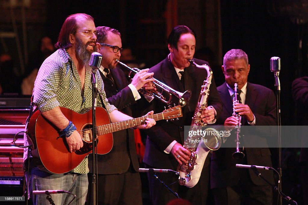 Musician <a gi-track='captionPersonalityLinkClicked' href=/galleries/search?phrase=Steve+Earle&family=editorial&specificpeople=214591 ng-click='$event.stopPropagation()'>Steve Earle</a> performs with Preservation Hall Jazz Band during On the Beach: A Sandy Relief Concert at Paramount Theater on January 2, 2013 in Asbury Park, New Jersey.