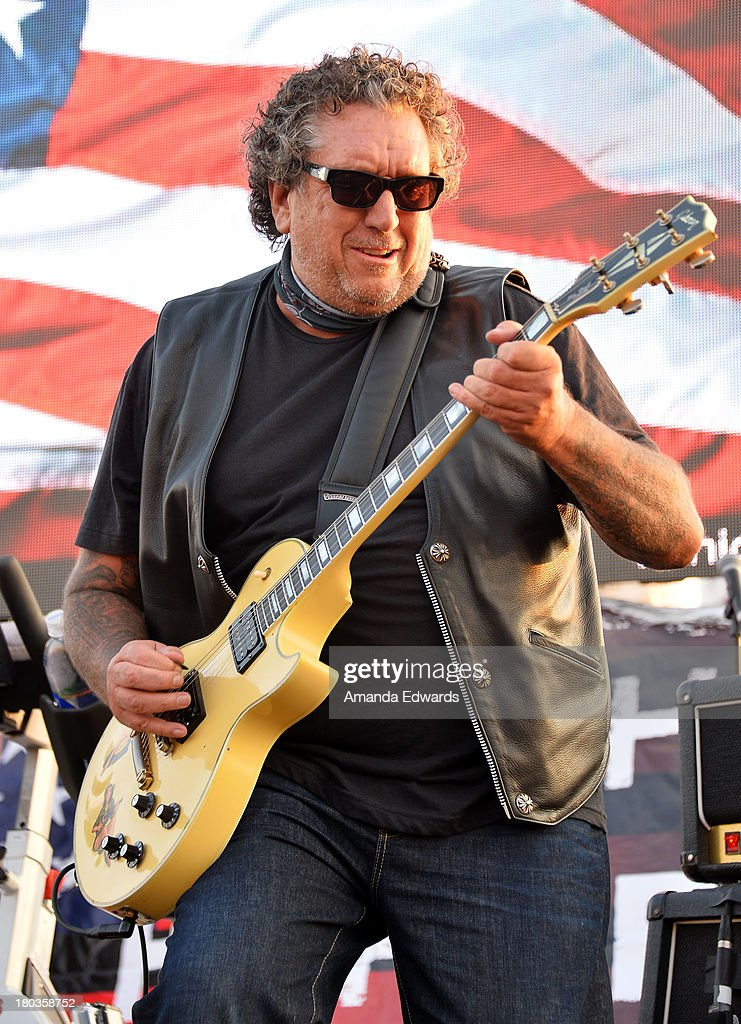 Musician Steve Jones performs the National Anthem onstage at the Cycle For Heroes: A Rock Inspired Ride On Santa Monica Pier at Santa Monica Pier on September 11, 2013 in Santa Monica, California.