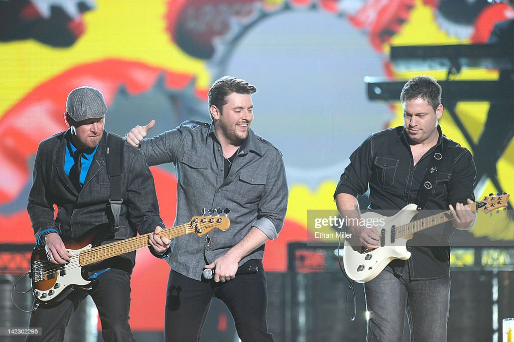 Musician Steve Seils, singer Chris Young and musician Kevin Collier perform onstage at the 47th Annual Academy Of Country Music Awards held at the MGM Grand Garden Arena on April 1, 2012 in Las Vegas, Nevada.