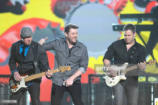 Musician Steve Seils singer Chris Young and musician Kevin Collier perform onstage at the 47th Annual Academy Of Country Music Awards held at the MGM...