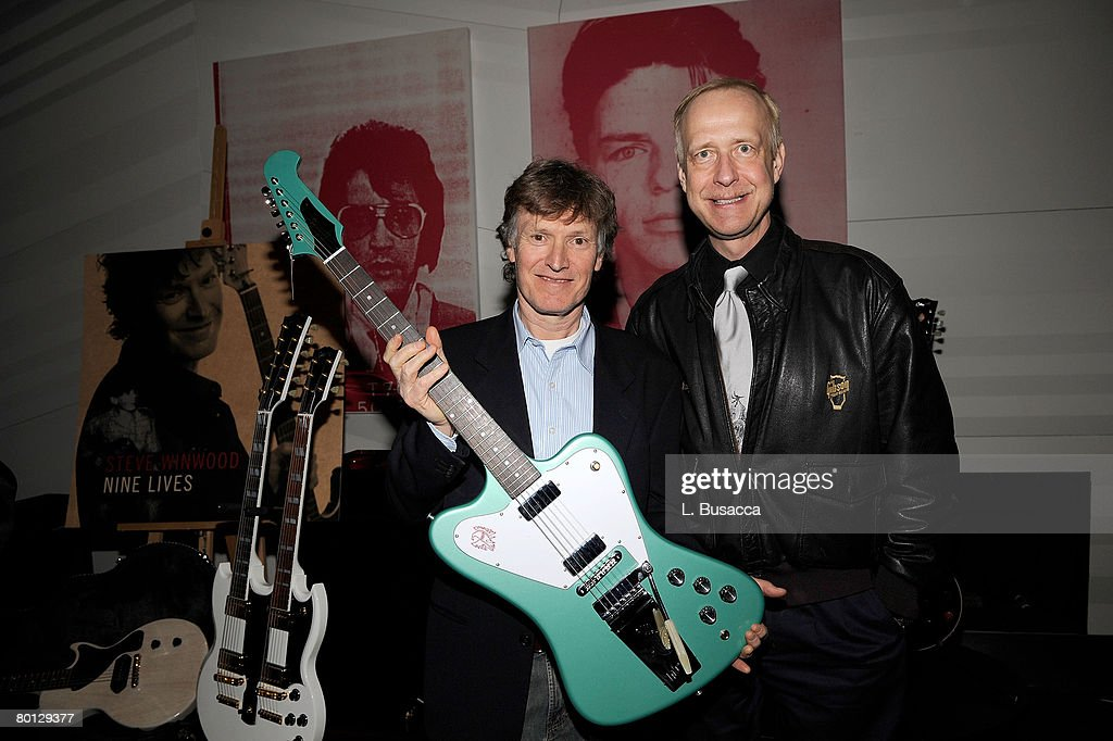 Musician Steve WInwood and Henry Juskiewicz Chairman and CEO of Gibson Guitars with a recreation of the Firebird model Gibson guitar at the listening party for the new Steve WInwood Album 'Nine Lives' on March 4, 2008 in New York City