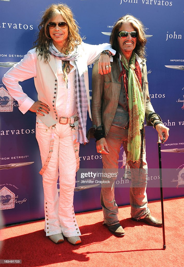 Musician <a gi-track='captionPersonalityLinkClicked' href=/galleries/search?phrase=Steven+Tyler+-+Musician&family=editorial&specificpeople=202080 ng-click='$event.stopPropagation()'>Steven Tyler</a> and Musician <a gi-track='captionPersonalityLinkClicked' href=/galleries/search?phrase=Joe+Perry+-+Musician&family=editorial&specificpeople=13600677 ng-click='$event.stopPropagation()'>Joe Perry</a> attend the John Varvatos 10th Annual Stuart House Benefit held at John Varvatos Los Angeles store on March 10, 2013 in Los Angeles, California.