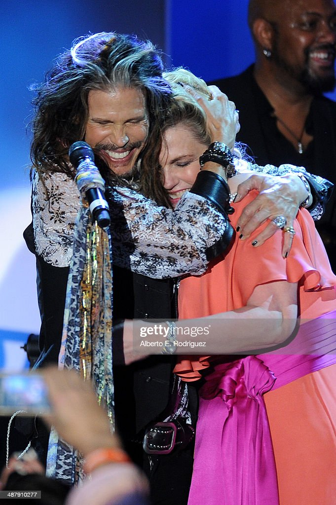 Musician Steven Tyler and Nancy Davis onstage at the 21st annual Race to Erase MS at the Hyatt Regency Century Plaza on May 2, 2014 in Century City, California.
