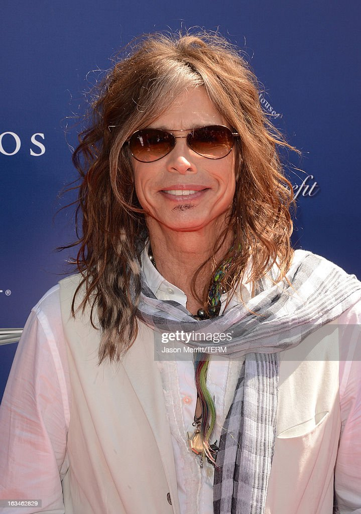 Musician <a gi-track='captionPersonalityLinkClicked' href=/galleries/search?phrase=Steven+Tyler+-+Musician&family=editorial&specificpeople=202080 ng-click='$event.stopPropagation()'>Steven Tyler</a> attends the John Varvatos 10th Annual Stuart House Benefit presented by Chrysler, Kids Tent by Hasbro Studios, at John Varvatos Los Angeles on March 10, 2013 in Los Angeles, California.