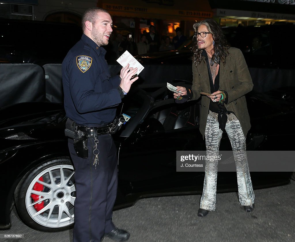 Musician Steven Tyler haggles over a parking ticket prior to the 'Steven Tyler...Out On A Limb' Kick Off Celebration at Lavo on April 30, 2016 in New York City.