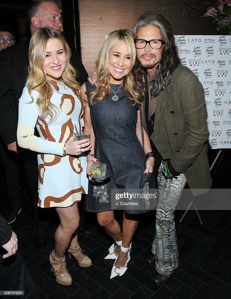 Musician Steven Tyler (R) poses for a photo at the 'Steven Tyler...Out On A Limb' Kick Off Celebration at Lavo on April 30, 2016 in New York City.