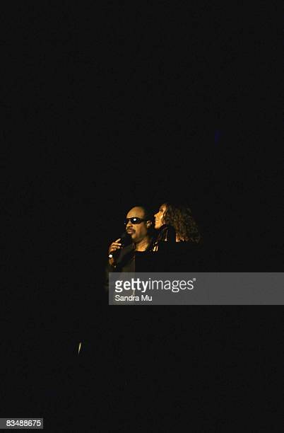 Musician Stevie Wonder is lead on stage by daughter Aisha Morris at Vector Arena on October 30 2008 in Auckland New Zealand