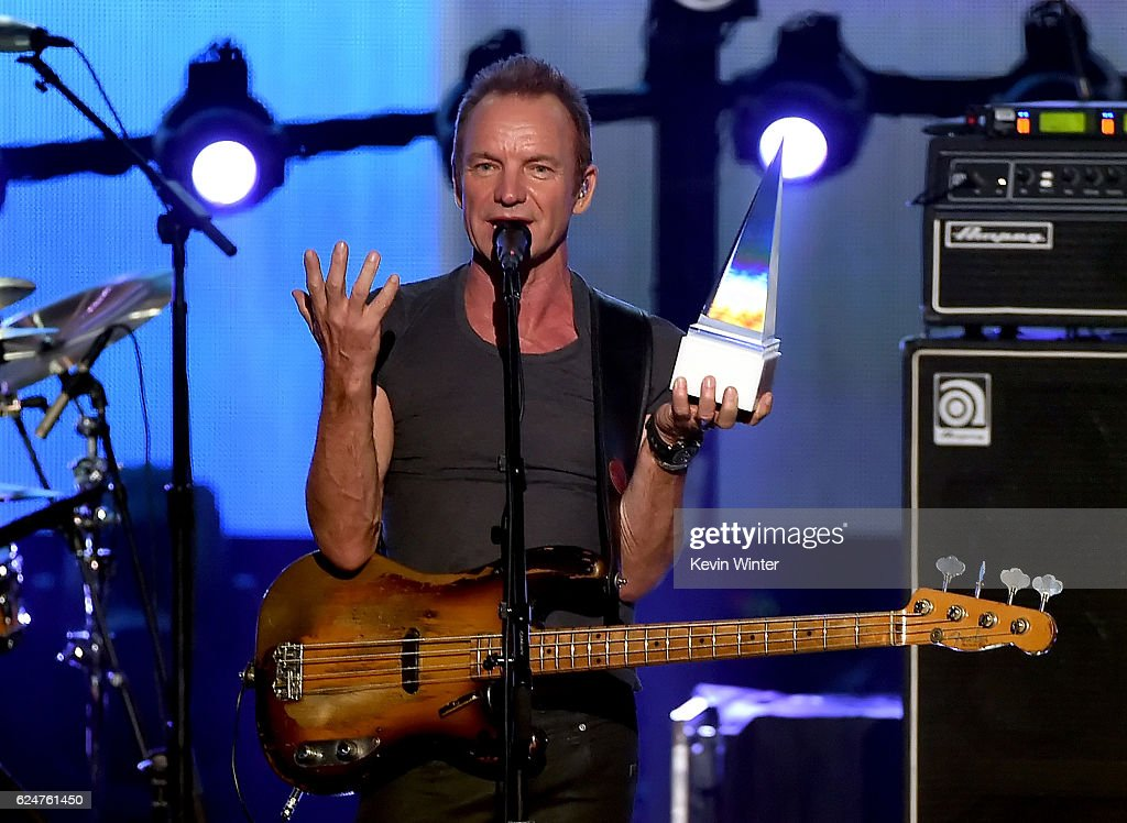 musician-sting-accepts-the-award-of-merit-onstage-during-the-2016-picture-id624761450