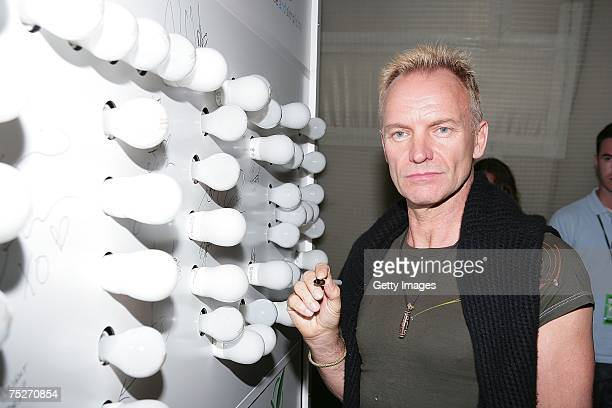 Musician Sting poses at the Philips 'Simple Switch' Light Wall at Live Earth New York at Giants Stadium on July 7 2007 in East Rutherford New Jersey