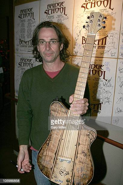Musician Stone Gossard of Pearl Jam poses backstage with a custom made 'Bridge School Benefit' guitar at the Shoreline Amphitheatre on October 23...