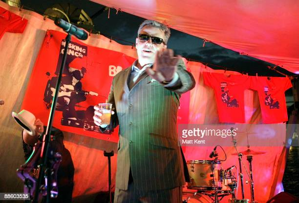 Musician Suggs of Madness performs at 'Busking for Cancer' on HMS Belfast on June 20 2009 in London England
