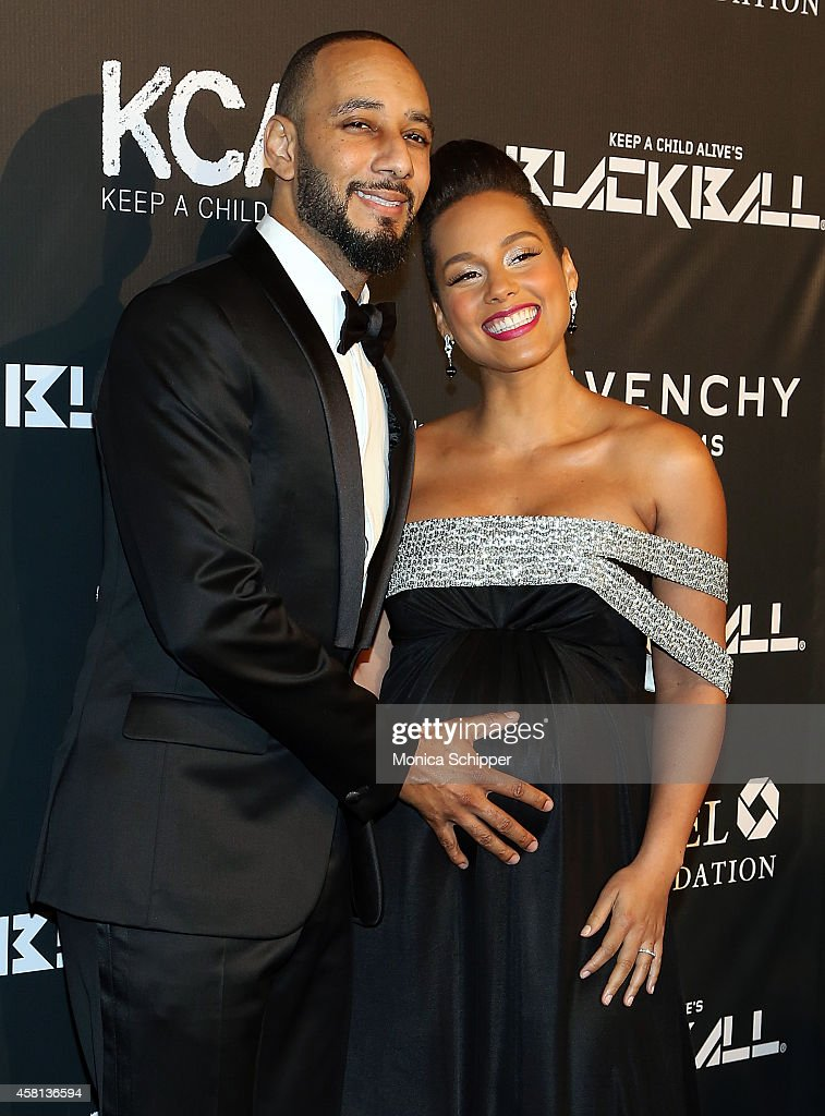 Musician Swizz Beatz (L) and singer-songwriter Alicia Keys attend the 9th annual Keep A Child Alive Black Ball at Hammerstein Ballroom on October 30, 2014 in New York City.