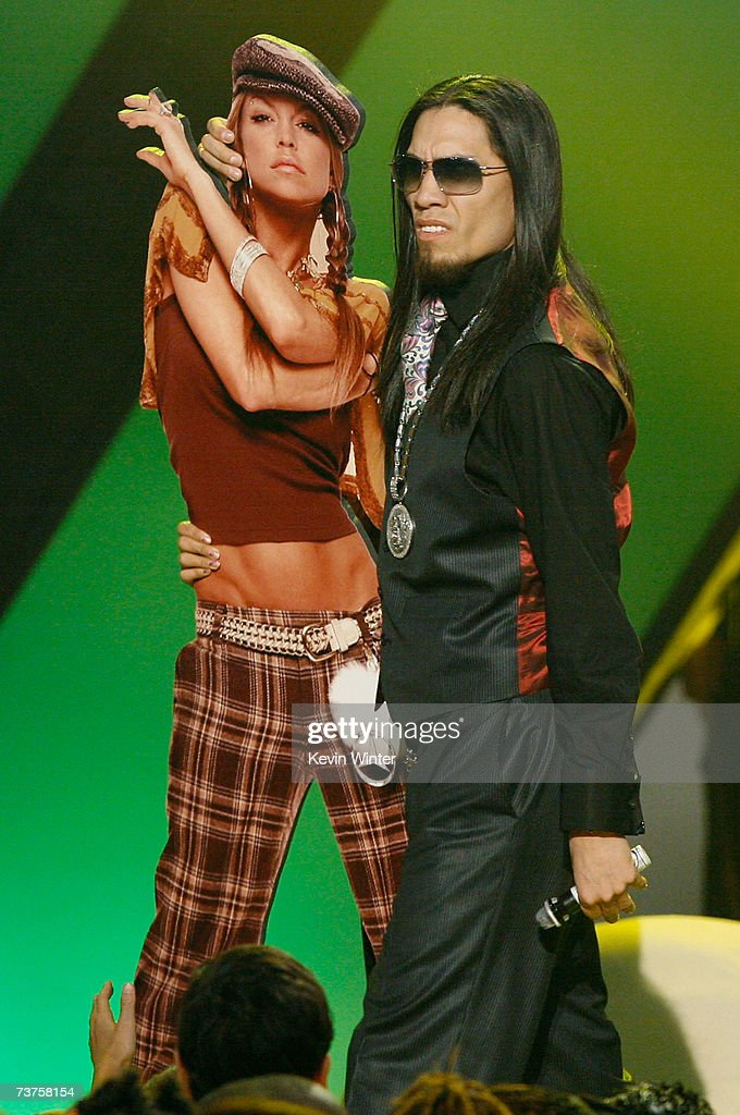 Musician Taboo poses with a cardboard cut out Fergie from the band The Black Eyed Peas as he accepts the 'Favorite Music Group' award onstage during...
