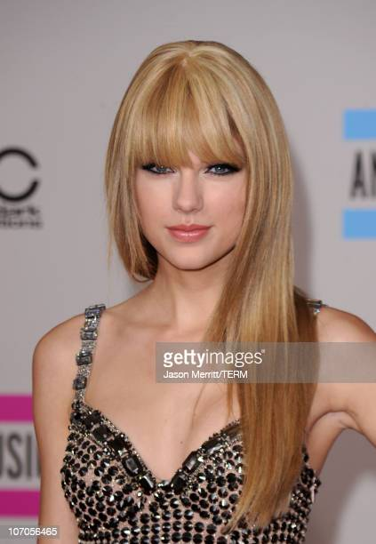 Musician Taylor Swift arrives at the 2010 American Music Awards held at Nokia Theatre LA Live on November 21 2010 in Los Angeles California