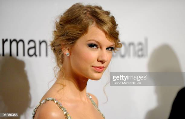 Musician Taylor Swift arrives at the 52nd Annual GRAMMY Awards Salute To Icons Honoring Doug Morris held at The Beverly Hilton Hotel on January 30...