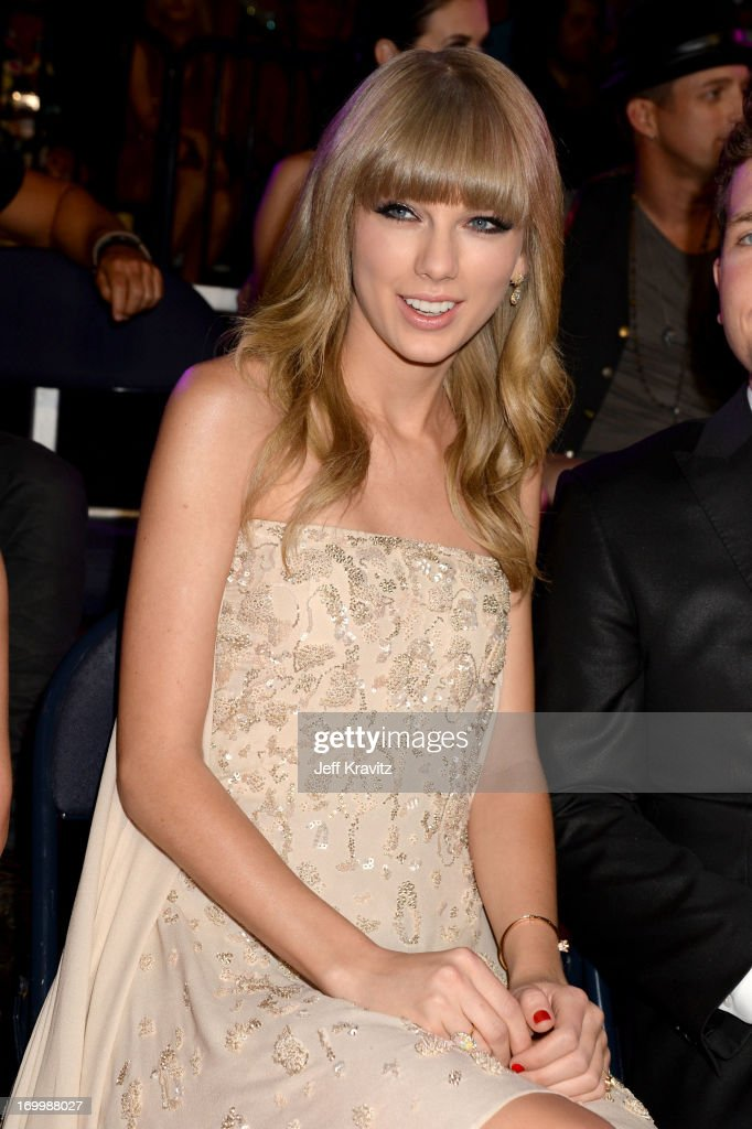 Musician <a gi-track='captionPersonalityLinkClicked' href=/galleries/search?phrase=Taylor+Swift&family=editorial&specificpeople=619504 ng-click='$event.stopPropagation()'>Taylor Swift</a> attends the 2013 CMT Music Awards at the Bridgestone Arena on June 5, 2013 in Nashville, Tennessee.