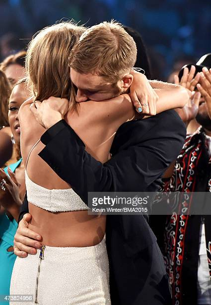 Musician Taylor Swift embraces musician Calvin Harris after winning the Top Artist award at the 2015 Billboard Music Awards at MGM Grand Garden Arena...