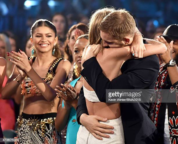 Musician Taylor Swift embraces musician Calvin Harris after winning the Top Artist award as actresssinger Zendaya looks on at the 2015 Billboard...
