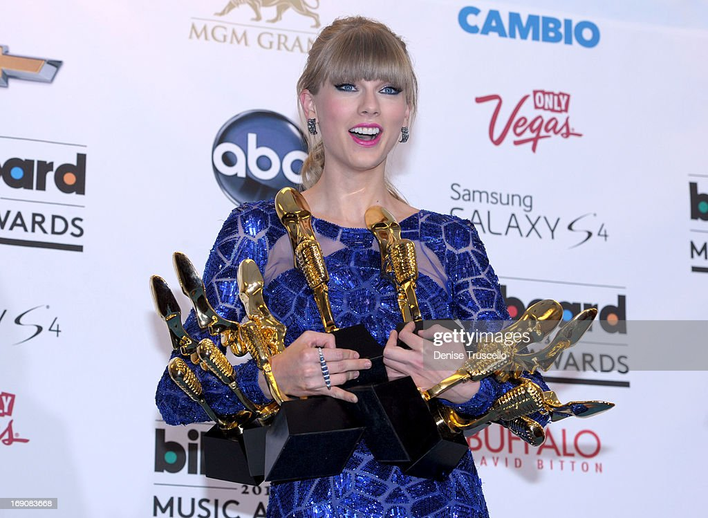 Musician Taylor Swift poses with awards in the press room during the 2013 Billboard Music Awards at the MGM Grand Garden Arena on May 19, 2013 in Las Vegas, Nevada.