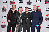Musician The Edge and singer Bono of U2 winners of the Innovator Award pose with Tom Poleman iHeart Media President of National Programming Platforms...