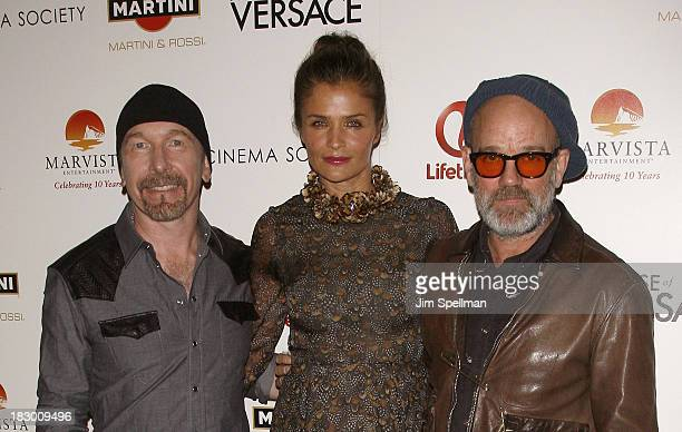 Musician The Edge model Helena Christensen and Musician Michael Stipe attend the Marvista Entertainment Lifetime with The Cinema Society screening of...