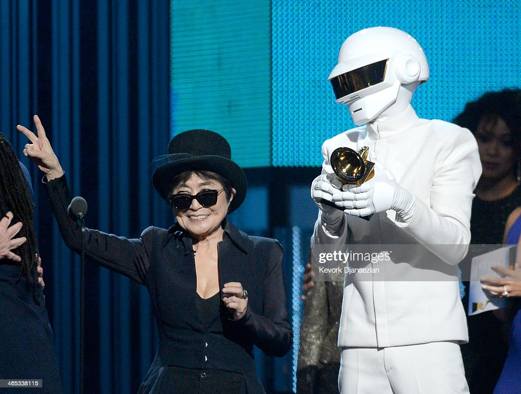 Musician Thomas Bangalter of Daft Punk (R) accepts the Album of the Year award for 'Random Access Memories' from musician <a gi-track='captionPersonalityLinkClicked' href=/galleries/search?phrase=Yoko+Ono&family=editorial&specificpeople=202054 ng-click='$event.stopPropagation()'>Yoko Ono</a> (L) onstage during the 56th GRAMMY Awards at Staples Center on January 26, 2014 in Los Angeles, California.