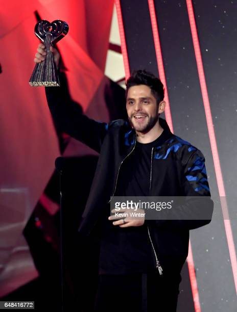 Musician Thomas Rhett accepts Country Artist of the Year onstage at the 2017 iHeartRadio Music Awards which broadcast live on Turner's TBS TNT and...
